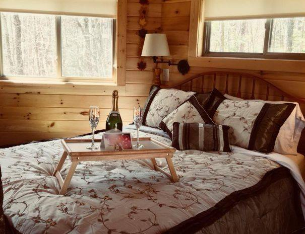 Holly Rock Treehouse Cabin King Bed with Champagne