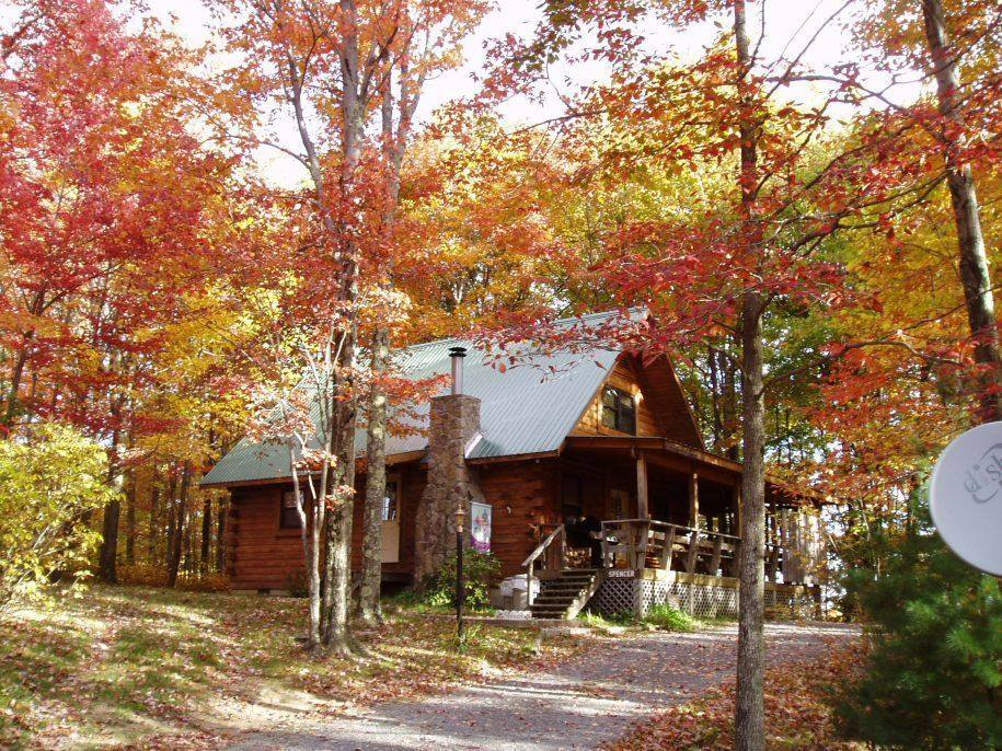 Spencer Cabin Outside with Fall Leaves