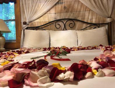 Hideaway Cabin King Bedroom with Flower Petals on Bed